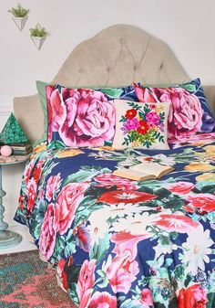 Blossoming and Turning Duvet Cover in Full/Queen   Mod Retro Vintage Decor Accessories   ModCloth.com  Though dreams sweet as can be are a guarantee with this floral duvet cover decorating your nest, you may lose a little sleep staying up to adore its ModCloth-exclusive design! Bursting with color and character from corner to corner, this navy bedding makes for restful nights and gorgeous mornings.