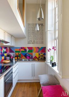 Coloured pattern tiles right above the counter slab of the kitchen | Kitchen ideas and inspiration