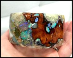 A one of a kind wood and gemstone cuff bracelet by Freestone Peach Designs. This piece features opals set in peach wood.
