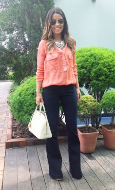 coral blouse, dark flare jeans, statement necklace