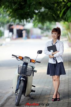 Cute teen girl + Honda Super Cub
