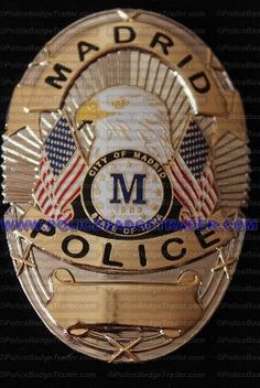 STATE OF IOWA - CITY OF MADRID POLICER OFFICER BADGE  City of Madrid Police Officer badge.  Reproduction badge. Attachment: Rear pin and roller. Available at www.policebadgetrader.com