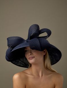 The Moet hat comprises a drop brimmed base trimmed with a double-looped 64ba7d0db7e2
