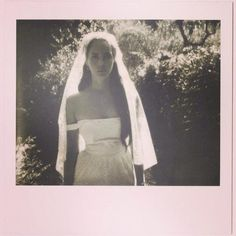 Lana Del Rey teases the upcoming new music video for her next single, 'Ultraviolence', while wearing a wedding dress. #LDR