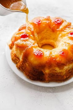 Pineapple Rum Cake Recipe – A homemade buttery sour cream pound cake is enhanc. - Pineapple Rum Cake Recipe – A homemade buttery sour cream pound cake is enhanced with sweet tropi - Just Desserts, Delicious Desserts, Sour Cream Pound Cake, Pineapple Cake, Pineapple Coconut, Pineapple Upside Down Bundt Cake Recipe, Pineapple Dessert Recipes, Pineapple Rum Sauce Recipe, Pineapple Rum Drinks