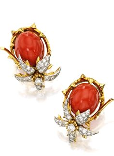 PAIR OF 18 KARAT GOLD, CORAL AND DIAMOND EARCLIPS, SCHLUMBERGER FOR TIFFANY & CO. Set with two coral cabochons measuring approximately 16.3 by 13.4 by 11.0 mm, within thorny flowering vine frames set with round diamonds weighing approximately 1.20 carats, signed Tiffany Schlumberger. With signed box.
