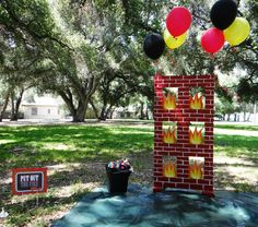 Love this idea... You could easily make this firefighter party decoration by cutting squares in cardboard and decorate!
