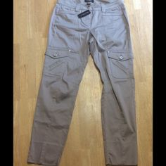 White House Black Marget New with tag cargo pants size 4 inseam 29 with a good 4 inches that could be let out to increase the length. No flaws and will consider any reasonable offer. Thank for looking. White House Black Market Pants Trousers