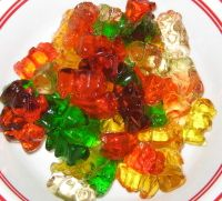 Drunken Gummy Bears:  Place gummies in a glass dish, pour enough vodka in to just cover the gummies.  Let them soak and swell up for 3 days and serve.  These are absolutely genius and soo good!  Vodka infused frogs or Rum infused coke bottles work well too :).