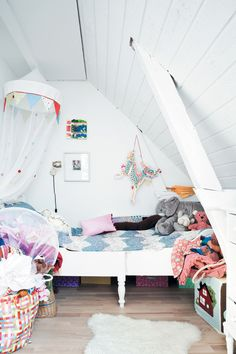 White and bright, this children's room outside of Copnhagen used to be an attic.