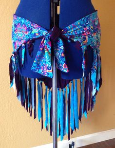 A personal favorite from my Etsy shop https://www.etsy.com/listing/399038365/belly-dance-hip-scarf-sm-hip-wrap-fringe
