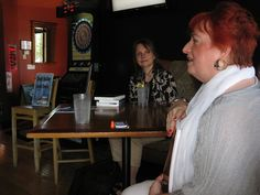 """Anne Nordhaus-Bike talks about """"Follow the Sun"""" as Jennie Spallone looks on Astrology Books, Chicago River, Book Signing, Book Art, Novels, Bike, Sun, Bicycle, Bicycles"""