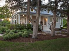 The home's original drive, repaved with pea gravel, leads to a gracious side entrance and flagstone walkway.