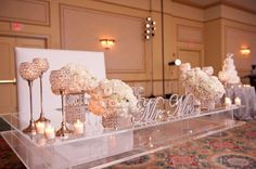 Sweetheart Table with all white flowers and lots of bling reception wedding flowers,  wedding decor, wedding flower centerpiece, wedding flower arrangement, add pic source on comment and we will update it. www.myfloweraffair.com can create this beautiful wedding flower look.