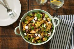 Warm Potato and Brussels Sprouts Salad - This festive potato and Brussels sprouts salad with dried cranberries and goat cheese is perfect as a Thanksgiving appetizer or side dish.