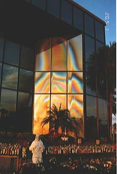 Believed to be a Marian apparition site where Mary's image spontaneously appeared on the glass windows of a Clearwater Florida office building in 1996--shortly after believers began to establish a shrine with devotional statues candles rosaries and flowers  Sadly in 2004 an 18 yr old with a sling shot broke the 2 upper pains of glass forming Mary's face