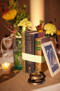 Book and Chalkboard centerpiece - Harry Potter (your favorite books - with post it note table numbers in frames?)