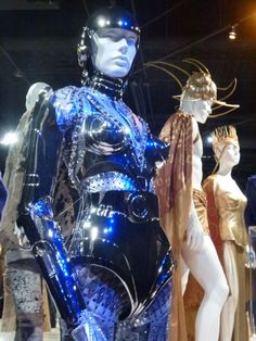 """A costume from """"Real Steel"""" in the foreground, futuristic tin bikini courtesy of Thierry Mugler.  The rest of robot girl's costume was by the film's costume designer.  In the background, Poseidon and Athena costumes for """"The Immortals"""" by Eiko.  Yeah, I didn't think they looked terribly Greek either..."""