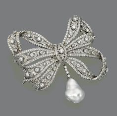 DIAMOND AND BAROQUE CULTURED PEARL BOW BROOCH The three-dimensional lacework bow set throughout with numerous round diamonds, suspending a baroque cultured pearl pendant supported on a collet-set diamond fringe, the total diamond weight  approximately 13.90 carats, mounted in 18 karat white gold, pendant  detachable.