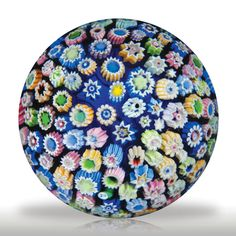 John Deacons undated close packed millefiori petite paperweight.(280) images