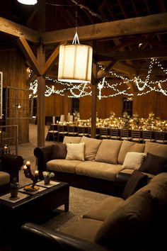 rustic wedding reception including a lounge area with couches, so cozy