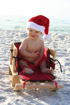 Christmas Beach Baby. Family pictures like these are only one benefit of a white sand rather then snow white Christmas.