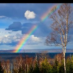 God's Grace in the form of a rainbow overlooking Little Traverse Bay in Petoskey, Michigan. On the other side of the bay is Harbor Springs.