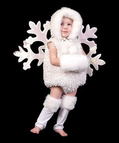 A furry muff and leg warmers combine with this plush hood and bubble bodysuit to create the warmest snowflake look ever. Hook and loop closures in back make it easy to put on and to attach the poufy snowflake wings. Includes bodysuit, snowflake wings, leg warmers, muff and hood100% polyesterSpot clean