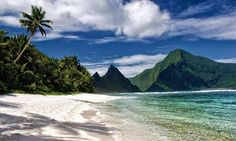 10 Least Visited Ntnl Parks in America: A secluded tropical sand beach and fringing reef in the Samoa National Park in Ofu Island, American Samoa