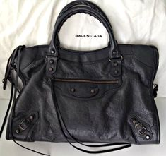 The Balenciaga Black City Bag :    Balenciaga Classic Black City Bag RH (Image Source here )    1) It is elegant yet understated and goes ...