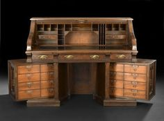 American Renaissance Revival Burled Walnut and Walnut Roll-Top Desk, with rotary pedestals, fourth quarter centu.