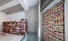 SYAA | O House ww.syaa.ro #house #interior #design #book #shelves #colorful #concrete #rug #geometric Book Shelves, Magazine Rack, Concrete, Divider, Colorful, Interior Design, Rugs, Storage, House