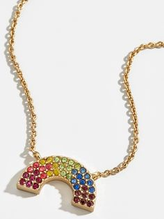 An embellished pendant features a sleek silhouette in the shape of a rainbow, while a colorful palette feels flirty and fresh. Pro tip: For added oomph, we love the idea of layering this piece with other necklaces.