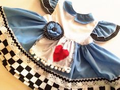 Alice in Wonderland baby dress. This would be perfect for my daughters 1st birthday party (Alice theme)