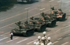 'Tank Man' by Jeff Widener/AP: A Chinese man stands alone to block a line of tanks heading east on Beijings Cangan Blvd. in Tiananmen Square on June 5, 1989. The man has never been identified. #Photography #Tank_Man #China