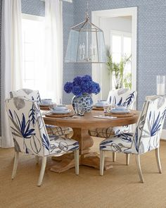 I like the patterned chairs and wallpaper but different color scheme