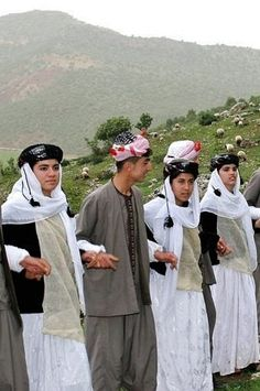 Yezidi folk dancers in traditional costumes.  Northern Iraq, ca. 2015.  These are recent workshop-made copies, as worn by folk dance groups.