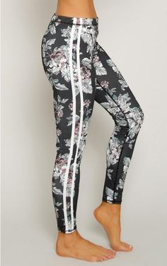 Performance leggings with faux mesh and floral print throughout with two striped sides.