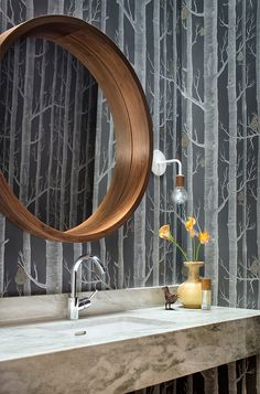 Three-Courts Residence || Allison Burke Interior Design || Austin, TX   Powder room has a uniquely carved skylight above that lights the vanity area and highlights the Cole & Son: Woods & Pears wallpaper.   Undermount Kohler Ladena sink with Hansgrohe Talis-S faucet. White and walnut sconces sourced from One Forty Three.