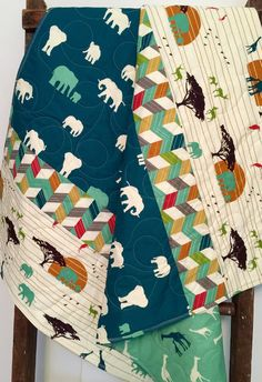 Adorable gender neutral - reversible - organic - blanket - serengeti - elephants - giraffes - safari - baby - crib or nursery quilt. This baby quilt