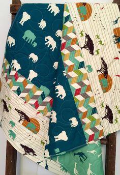 Adorable gender neutral - reversible - organic - blanket - serengeti - elephants - giraffes - safari - baby - crib or nursery quilt. This baby quilt