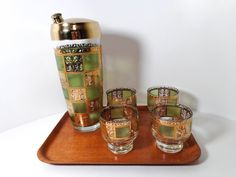 Mid Century Culver LTD 22k Gold, Prado Green Pattern, set of Cocktail Shaker with 4 on the rocks glasses. (Sold)