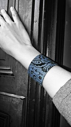 I've always loved cuff bracelets because I have such small wrists and they are slightly adjustable. This Denim Brocade Rhinestone bracelet is just that and is accented with hints of Black Swarovski elements in between the luxurious velvet paisley print. Just enough sparkle for day and night wear. Total Width: 1 3/4 in