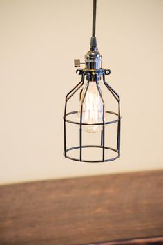 Industrial style pendant with wire cage bulb holder and heavy gauge  3/way socket