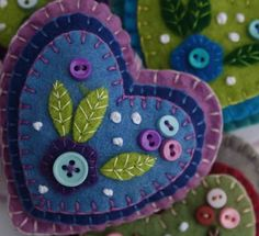Hanging Heart Ornament~Valentines Gift, Blue Felt, Buttons & Applique BY PuffinPatchwork @Etsy: Felt hanging heart w/ layers of applique & embroidery in blues & lilac, embellished w/ tiny buttons. A perfect gift or decoration. 9cm x 8cm approx, w/ a ribbon loop for hanging. Blue & lilac. Please see separate listings for other colours.