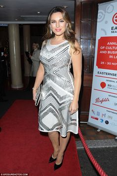 Glam squad: Kelly Brook made the most of her killer hourglass figure as she arrived at a gala dinner in London on Monday night