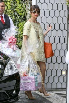 Kourtney Kardashian wearing Tom Ford Brown Rhonda Sunglasses, Hermes Orange Birkin, Manolo Blahnik BB Pointed-Toe Pumps in Camel and Amber Sakai Spring 2013 Dress.