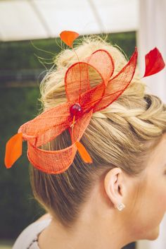 """In case guests don't come prepared for the Kentucky Derby theme, have a fascinator """"bar"""" for the ladies to get all dolled up. Not only are these amazing take-home gifts, but they really add to the festive vibes."""