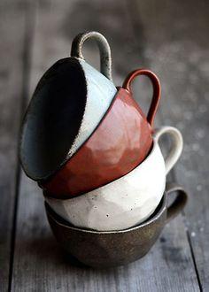 stacked handmade tea cups