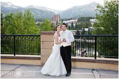 Bride and groom pose with the mountains behind them at Main Street Station's outdoor patio during their wedding reception in Breckenridge, CO @wyndhamvacation  - April O'Hare Photography http://www.apriloharephotography.com #Breckenridge #Colorado #ColoradoWedding #BreckenridgeWedding #BreckWedding #MainStreetStation